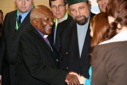 Archbishop emeritas Desmond Tutu greets Shaykh Rashid and family